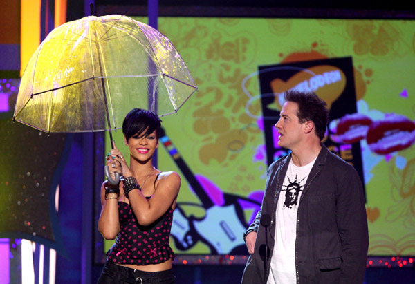 rod blagojevich umbrella. Rihanna and Chris Brown both